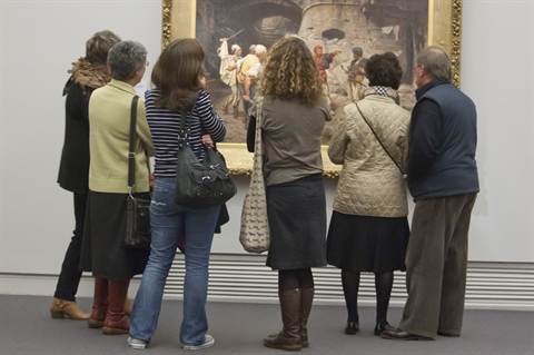 group standing around a painting